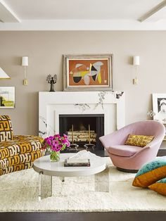 Marisa Tomei's Living Room - taupe walls, white marble fireplace, accents of pink and orange