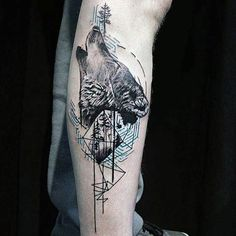 Guy With Geometric Tattoo Of Wolf Howling On Upper Arm