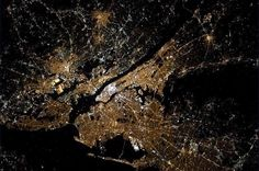 NYC. New York City shining by night. Central Park is visible from space.