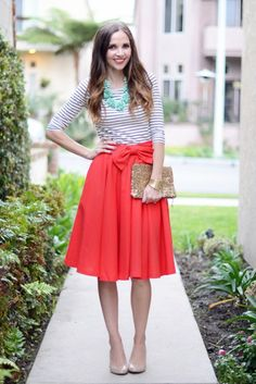 If you're feeling like red and green together is just TOO Christmas-y, then try mint and red! Here I paired a traditional bright red skirt with a striped shirt, a mint statement necklace, and some nude heels. This outfit is perfect for both a date night or a Christmas party – it's appropriate for work, but comfortable enough for staying at home!