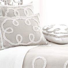 Platinum and white bedding.