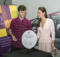 4/23/14 Kate signs a drum skin at youth centre in Adelaide, Australia.