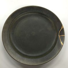 Black dish with kintsugi repair