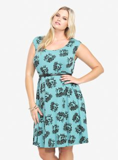 This teal skater dress has cap sleeves and a detailed floral skull print on it in black. Made from super soft jersey knit, the darling dress has a flirty back keyhole and comes with a black skinny belt.