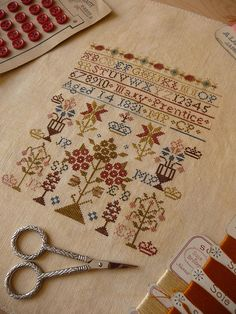 A sampler... I want to make one to hang outside of our tent! I'd have to date it for the early 50s and pretend I did it when I was 6... my embroidery skills are severely lacking by 19thC standards D: