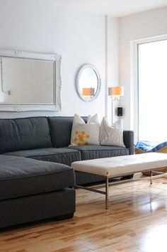 This is my dream couch. Comfy, durable fabric, charcoal color. Minimalist decor. Can I live here?