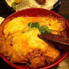 Insanely awesome tsukune-don.  That's ground chicken and runny eggs over rice.