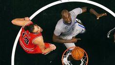 Kevin Garnett pretends to bite Joakim Noah during Nets-Bulls game