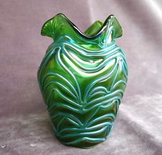 """*LOETZ ~ Art Nouveau Era.  it is a documented Loetz piece called Formosa which Loetz only produced in 1905. It has a beautiful iridenscence w/ a raised ribbed ice blue design over an emerald field. It absolutely comes alive, 4 3/4"""" tall w/ fluted top + ribbed body. It has an excellent polished pontil on the base."""