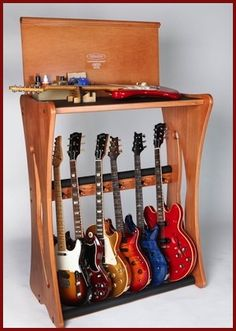 DIY guitar/banjo/instrument stand - Use this design - shelf over top for other instruments - Probably just use triangle type sides with two bars along the bottom plus moveable pegs for bracing.  Make it hold at least a few extra...hooks along the side for tambourine, etc. - maybe put it on wheels?