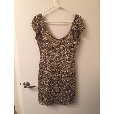Sequined Scala Mini  Dress. Multi colored metallic sequined mini dress. Scoop neck, cap sleeves. Perfect for NYE!! Never worn and tags still on!! Scala Dresses Mini