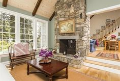 Traditional Living Room with Exposed beam, Hardwood floors, Paint1, stone fireplace, High ceiling, Carpet
