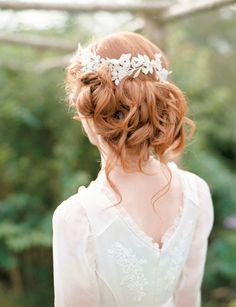 Curled chignon with a headpiece. #weddinghair