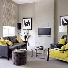 Integrated entertainment system A chimney breast decorated with bespoke contemporary-style panelling that incorporates a wall-mounted TV makes an interesting focal point. The dark seating scattered with bright cushion adss accents of colour to the scheme, drawing attention away from the TV.