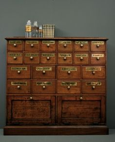9th Century English Oak Apothecary Cabinet with original Brass Handles & Gold Leaf Labels