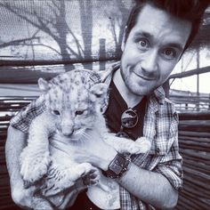 Two of the most adorable things on the planet combined in one picture!!!! *dies in his arms* Lol