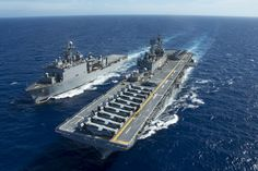 EAST CHINA SEA (June 5, 2015) The amphibious assault ship USS Bonhomme Richard (LHD 6) and dock landing ship USS Ashland (LSD 48) maneuver to conduct a replenishment at sea.