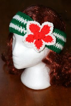 This adorable Head Warmer is perfect for this holiday season. Not only will it spice up your outfit, it will also keep you warm! This green and white head warmer is embellished with a red flower making it perfect for Christmas.
