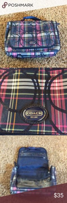 Coach Make up bag 💼. Pink,Blue, gold and White. In Used Great Condition Coach Make up Bag. Opens up and can be hung. Great for travel. Has 3 zippered pockets, and 3 Elastic pockets. Coach Bags Cosmetic Bags & Cases
