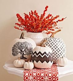 Don't let these pumpkins fool you; the designs may look painted, but the patterns are actually created with tissue paper. // Midwest Living magazine