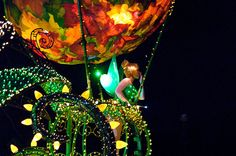 Tinker Bell leads the way in the Main Street Electrical Parade! See Tink under the spotlight - Five Magical Tinker Bell Facts!