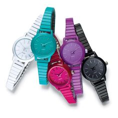 """Classic and colorful stretch watch, perfect for summer FEATURES; Colorful round faced expansion band watch; Face and bezel of watch match the color of the band; Offered in your choice of White, Teal, Fuchsia, Purple, and Black; One size fits most• Band is 6 1/4"""" L (unstretched) X 1/4"""" W• 1 3/16"""" round without casing &1 7/16"""" with casing• SR626SW replaceable battery• Quartz PC21J movement• 23 grams grams in weight• Expansion watchMATE..."""