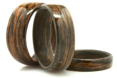 Bog oak is wood from an oak tree that has fallen many years ago and has been preserved in peat bogs. The rare wood we use for these rings has been dated to 4000 BC, so the tree fell about 6000 years ago. The bogs preserve the wood but also tend to darken oak, producing the nice grain pattern seen in these rings.