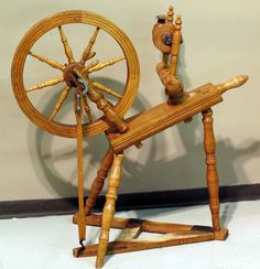 Hutterite spinning wheel. Oak, birch and pine with original  finish. Decorative turnings and pinwheel design motif. Dated  1938. Sourced a the Wolf Creek Hutterite Colony, Magrath, Ab.