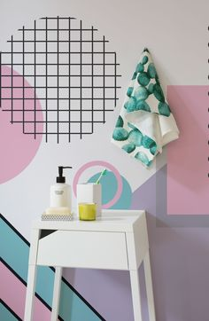 Bring some fun into your bathroom spaces with this daring Memphis wallpaper design. The iconic pastel pink and purple hues of the 80's come together to give your walls an instant colour revamp.