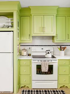 Backsplash in Kitchens on a Budget: Our 14 Favorites From Rate My Space from HGTV. I love this green kitchen!