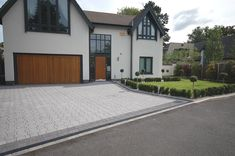 A modern driveway style can improve the curb appeal of your house. Some of the most popular types of modern driveway products in usage for high-end houses Front Garden Ideas Driveway, Modern Driveway, Driveway Design, Driveway Landscaping, Landscaping Ideas, Landscaping Software, Block Paving Driveway, Resin Driveway, Grey Block Paving