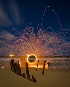 sparks + long exposure - did not read it yet, but I imagine it is done with steel wool that has been lit & swung in a circle