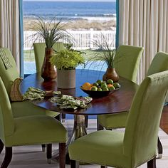 Lime green upholstered chairs mirror the green grass that this Neptune Beach, Florida, dining room overlooks. A capiz shell light fixture and a polished brown wood table with a silver base offer modern island touches. Coastal Living, Coastal Decor, Southern Living, Green Dining Room, Ideas Hogar, Dining Area, Dining Rooms, Tropical Decor, Upholstered Chairs
