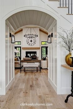 A beautiful, millwork-wrapped archway welcomes you into this Modern Farmhouse ho. A beautiful, millwork-wrapped archway welcomes you into this Modern Farmhouse home. Modern Farmhouse Interiors, Modern Farmhouse Kitchens, Farmhouse Homes, Modern Farmhouse Lighting, Farmhouse Contemporary, Craftsman Farmhouse, Farmhouse Door, Modern Farmhouse Design, Farmhouse Ideas