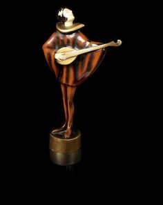 Roland Paris An Art Deco Cold-Painted Bronze and Carved Ivory, circa 1925