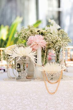 Mini floral arrangements look even more darling when paired with vintage crystal glasses, antique pearl necklaces, and lace table cloths.