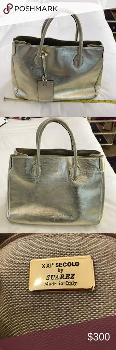 XXI Secolo by Suarez Gold Handbag XXI Secolo by Suarez handbag in gold. Great for a day or night time look!!! Barely used! Suarez Bags Shoulder Bags
