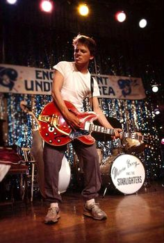 "Michael J Fox as Marty McFly rocking out to ""Johnny B. Goode"", Back To The Future Michael J Fox, Marty Mcfly, 80s Movies, Great Movies, Movie Tv, Movie Scene, Indie Movies, Comedy Movies, Action Movies"