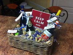 """Basket of Firsts"" for a stock the bar wedding shower. First Night as a Married Couple - champagne. First Fight - Tequila. First Christmas - red wine. First Night Home as a Married Couple - Brides fav. wine. First Dinner Party - Riesling."