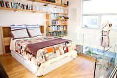 This is at the top end of the wall of books... More books and this cozy quilt