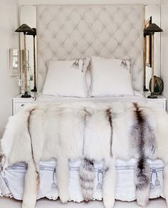 headboard with mirrored side panels and fur throw