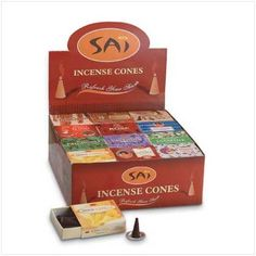 """Refresh your senses! Each box of Sai incense cones includes 10 savory scented cones and a metal burner.   Eleven different scents, including charming jasmine and peaceful patchouli. 2 3/4"""" x 2 1/4"""" box. Sold in a pack of 48."""