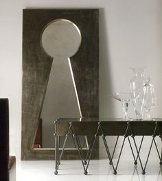 A spectacular mirror shown here with antiqued silver leaf frame and antiqued mirror glass.
