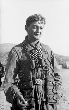 A German member of the I./FJR 2 Fallschirmjäger (Paratroopers) waits on German occupied Crete to be dropped onto the Greek island of Leros, which had been invaded by the British in September 1943 during the Battle of Leros of the Dodecanese Campaign. Crete, Greece. 11 November 1943.