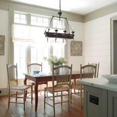 painted plank walls, transoms, gray green trim