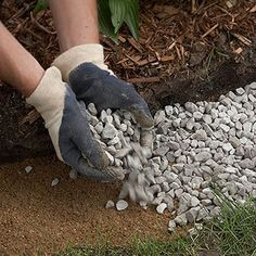 Step 2 Cover the bottom of the trench with a 1- to 2-inch-deep layer of sand; top with a 1- to 2-inch-deep layer of road-base gravel.