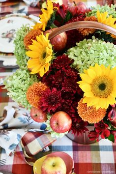 Welcome fall and create a floral arrangement incorporating apples.No flower arranging skills required for this easy flower arranging method! ©homeiswheretheboatis.net #fall #tablescapes #apples #plaid #sunflowers Apple Fritter Bread, Apple Fritters, Apple Loaf, Pumpkin Loaf, Apple Bread, Peach Dumplings, Homemade Vanilla Extract, Printed Napkins, Fall Table