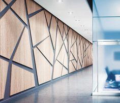 wrapped square edge with recessed reveal. Nicely executed geometric paneling in a office. Definitely a attention getter