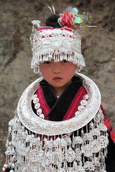 A child photographed during the  Sisters' Meals Festival Of Miao Ethnic Group, China.    © Rudi Roels, via Flickr