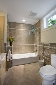 I like the way they did the tub/ shower combo here but not necessarily the tile or design. Tiled Tub Shower Combo | Brown brick looking tile with tub and shower combo